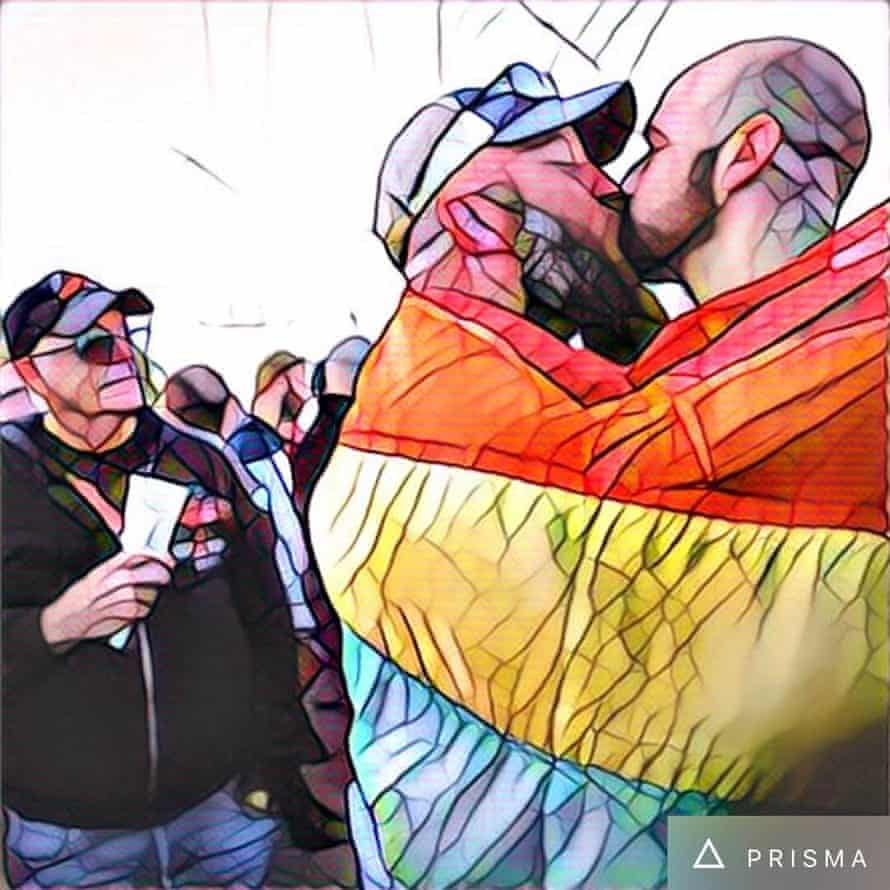 A couple shares a kiss in San Francisco at a gathering to remember the victims of the Orlando LGBT nightclub mass shooting.