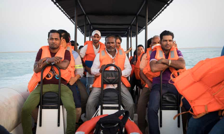 Workers from The Heart of Europe, a cluster of six islands on The World in Dubai, aboard a speedboat to take them back to the mainland after a day's work.