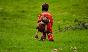 A toddler walks inside the humanitarian camp in Bogotá