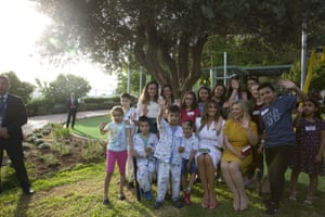 Melania Trump and Sara Netanyahu pose with children during a visit to the Hadassa hospital in Jerusalem