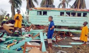 Children sort through the wreckage of a school near St George's Grenada, after Hurricane Ivan hit in 2004