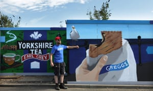 Frankie Styles with his mural featuring Yorkshire and a Greggs steak bake