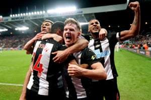 Newcastle United's Isaac Hayden celebrates is congratulated by his teammates after scoring.