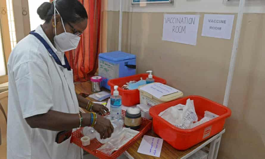 A health official prepares a vaccine kit during a drill for Covid-19 coronavirus vaccine delivery.