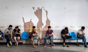 Migrant workers wait at a job centre