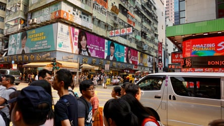 People and cars on Sai Yeung Choi Street South