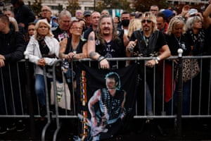 Fans attend a tribute ceremony for the late singer Johnny Hallyday in Paris, France