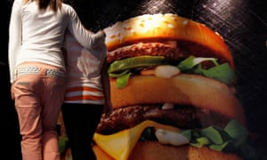 Mother and daughter contemplate giant burger