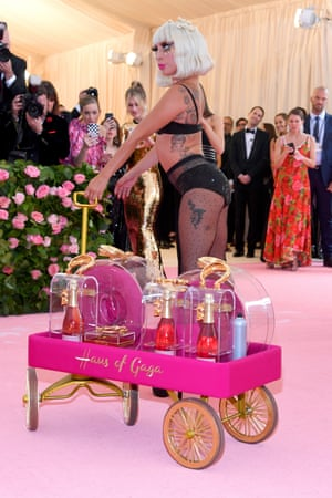 Lady Gaga in another of her multiple outfits, which she slowly revealed as she walked the pink carpet