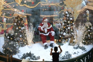 Brasilia, BrazilA Santa Claus waves to children from inside a bubble, a protective measure against the spread of COVID-19, at a shopping centre