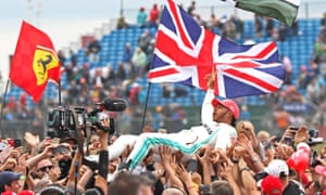 Lewis Hamilton crowd surfs after winning the Formula One Grand Prix 2019 at Silverstone