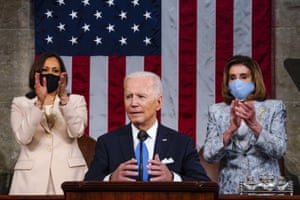 For the first time the president was flanked by two women, Kamala Harris and House speaker Nancy Pelosi, as he spoke.