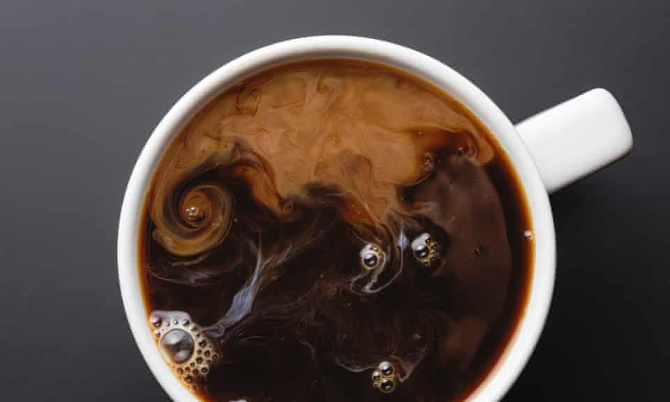 View from above coffee with swirling cream
