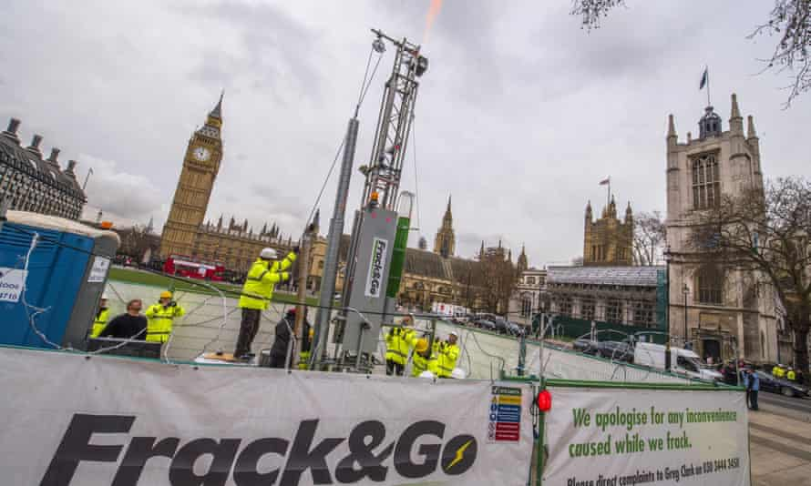 Greenpeace workers protest against fracking outside Westminster, London.