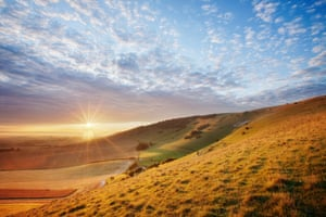 South Downs National Park, UK Sunrise over chalk downland viewed from Wilmington Hill. The South Downs National Park is celebrating its 10th anniversary by renewing its commitment to protecting the biodiversity of the beauty spot as the challenges caused by climate change intensify