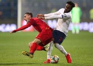England's Danny Rose (right) fouls Montenegro's Aleksandar Boljevic.