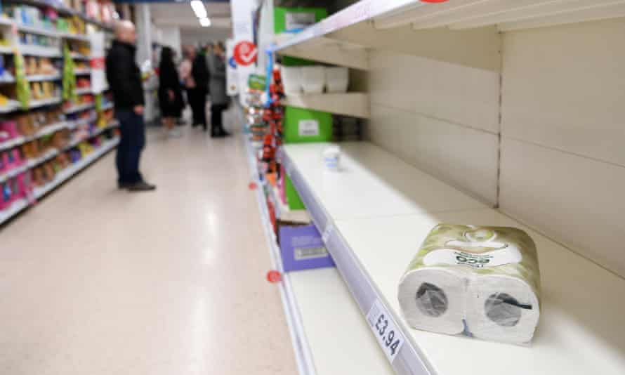 Empty toilet paper shelves at a supermarket in London on 12 March.