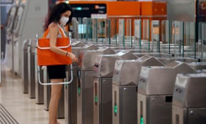 A woman makes her way to the beach in Barcelona on the city's metro