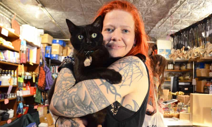 enchantments owner and witch stacy rapp with a resident cat