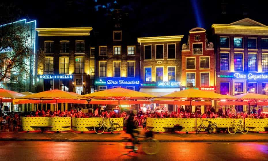 A cyclist travels through Grote Markt in Groningen.