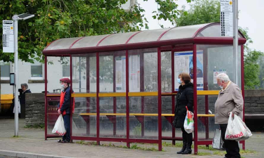 Passengers waiting at a bus stop