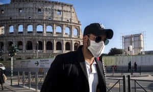 A tourist wearing a face mask visits the Colosseum in Rome, Italy, on 24 February.