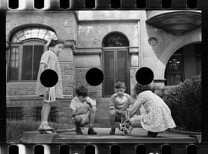 Children playing, with three large black circles across centre of image