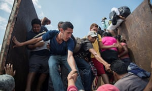 People on the migrant caravan travel through Mexico toward the US on 7 November.