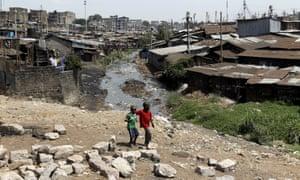 Boys walk the Mathare valley slums in Kenya's capital, Nairobi.