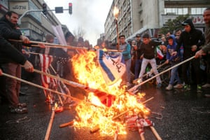 Iranians burn US flags during a ceremony to mark the anniversary