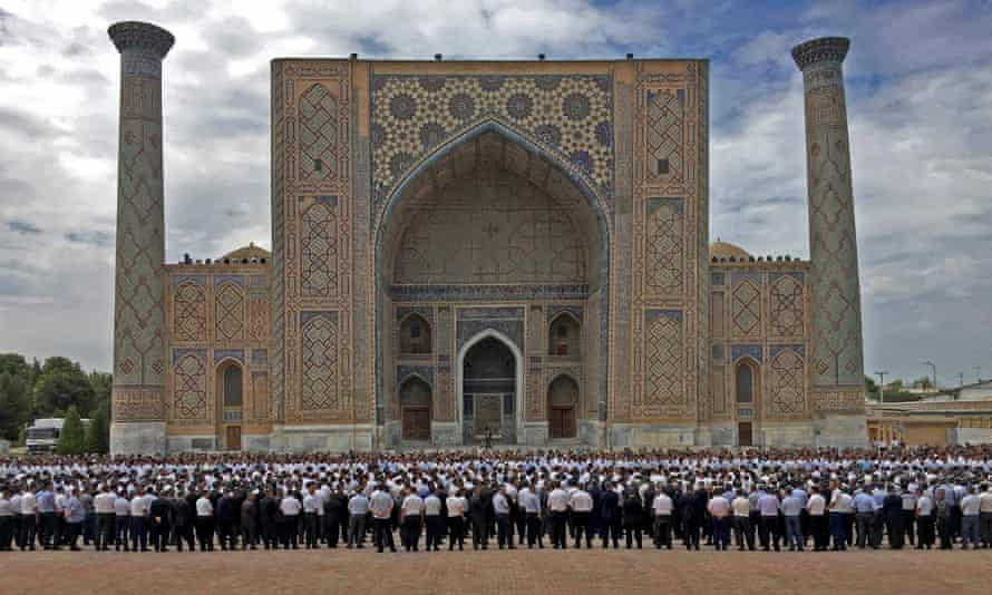 People gather to attend a mourning ceremony following the death of Islam Karimov in Registan Square, Samarkand.