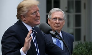 Mitch McConnell watches Donald Trump speak in the White House rose garden this week.