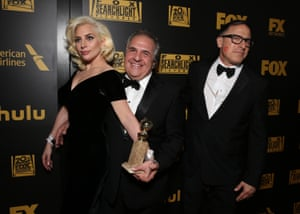 Golden Globe winner Lady Gaga with Jim Gianopulos, chairman and CEO of 20th Century Fox, and writer/director David O Russell at Fox's after party.