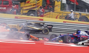 McLaren's Fernando Alonso, left, and Toro Rosso driver Daniil Kyvat, right, crash at the start of the Austrian Grand Prix  at Spielberg in July