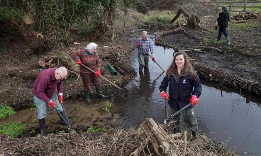Volunteers clearing a waterway.