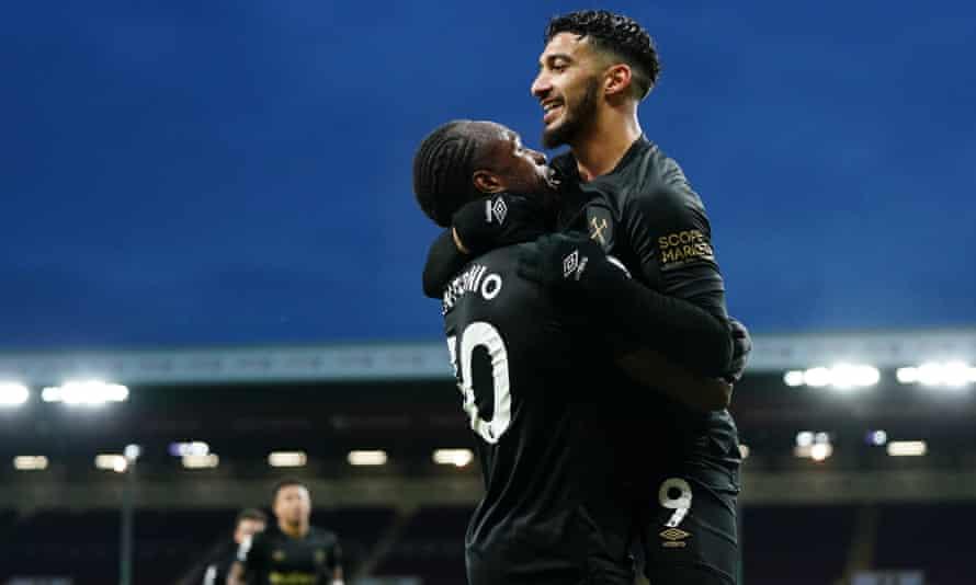 Michail Antonio celebrates with Saïd Benrahma after scoring West Ham's second goal at Burnley
