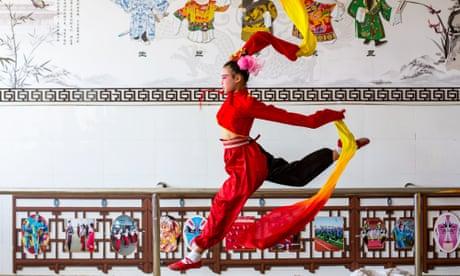 Peking opera and drive-in prayers: Wednesday's best photos