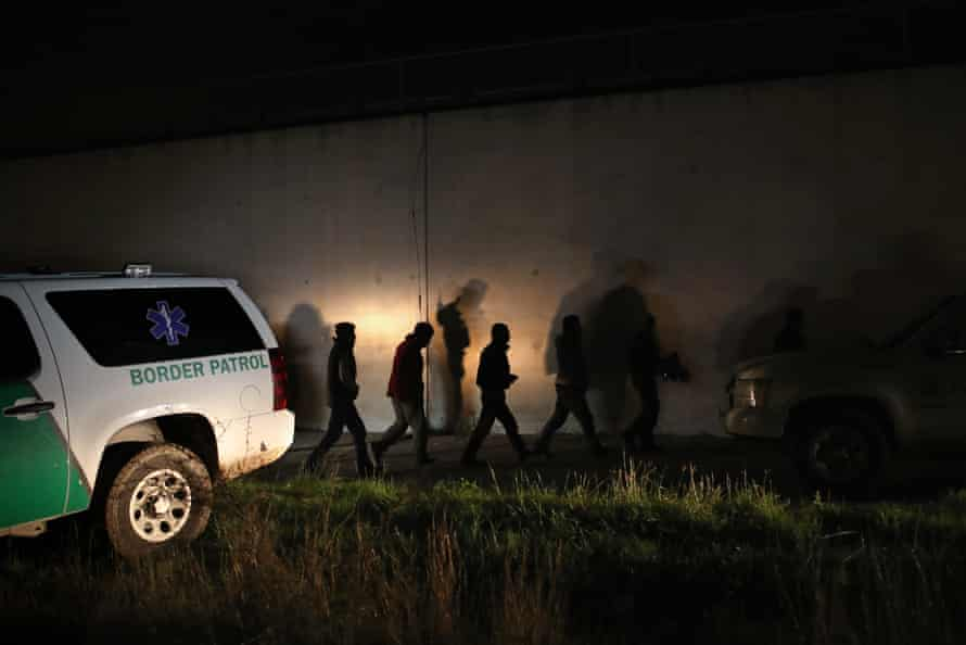 Undocumented immigrants are taken into custody by Border Patrol agents on February 22, 2018 near McAllen, Texas.