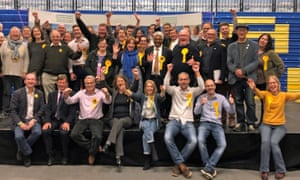 Liberal Democrat activists celebrate winning control of Bath and North East Somerset council on Friday morning.