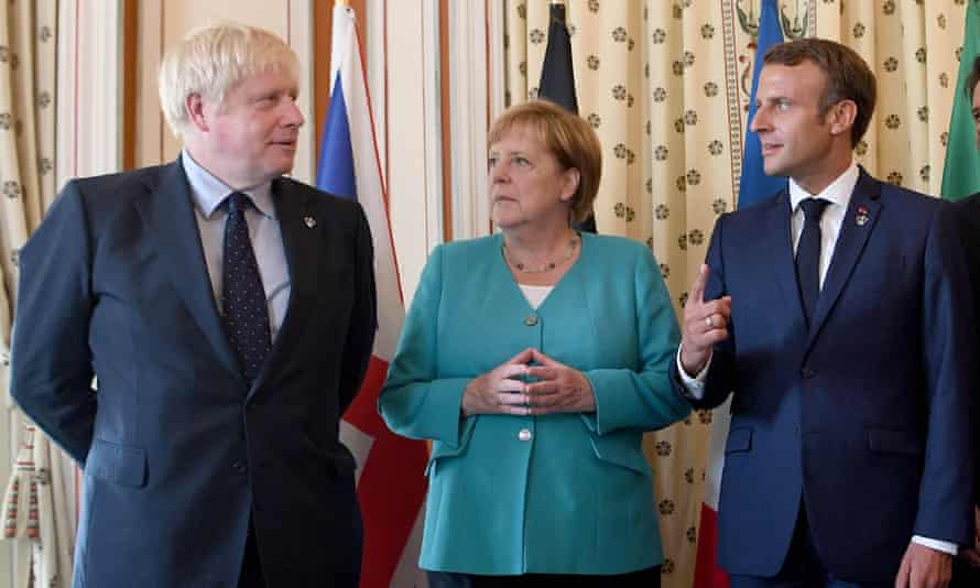 Boris Johnson with Angela Merkel and Emmanuel Macron at the EU meeting during the G7 summit in 2019