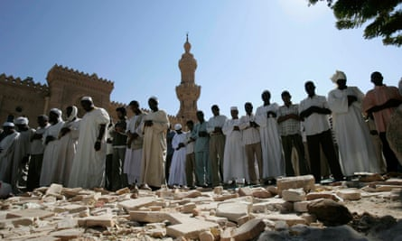 Sudanese men take part in Friday prayers outside the Great Mosque in Khartoum.
