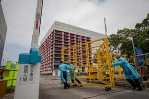 Workers close a gate outside Sheung Shui Slaughterhouse in Hong Kong.