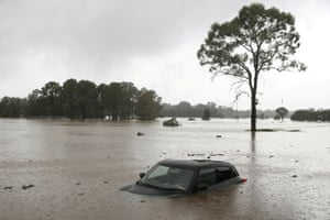 Sydney, Australia: A partially submerged car left abandoned in the suburb of Windsor after widespread flooding in New South Wales.