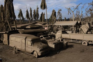 Agoncillo, Philippines. Vehicles are covered in ash from the Taal volcano. Leaving decimated fish, scarred coffee plants and vanished tourists in its wake, the eruption has devastated the livelihoods of tens of thousands of people