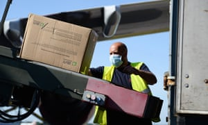 A worker in Bournemouth unloads PPE flown over from China.