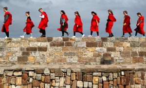 New students at the University of St Andrews take part in the traditional pier walk before the start of the new academic year.