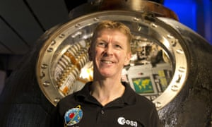 British astronaut Tim Peake stands by his Russian built Soyuz TMA-19M return capsule at the Science Museum, January 2017.