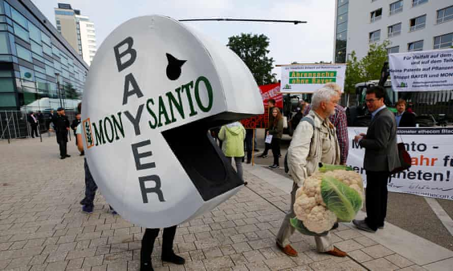 Activists protest against the merger of Bayer and Monsanto in Bonn, Germany, in 2018.