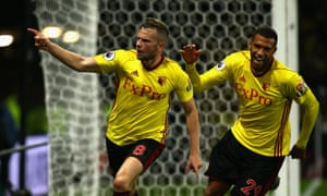 Tom Cleverley runs off towards the fans after his winner against Arsenal with his Watford team-mate Étienne Capoue in pursuit.