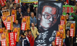 Pro-democracy lawmakers and demonstrators carrying banners demanding Liu Xiaobo's release at a rally in Hong Kong, China, in 2010.